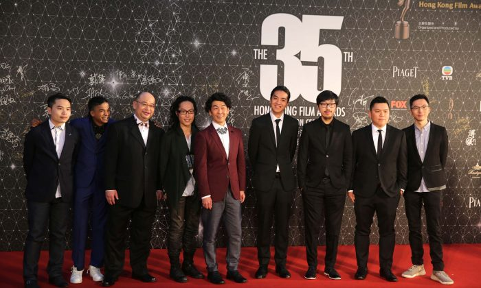 "Cast and Crew from the Hong Kong film ""Ten Years,"" pose for a photo on the red carpet at the Hong Kong Film Awards on April 3, 2016. (Isaac Lawrence/AFP/Getty Images)"