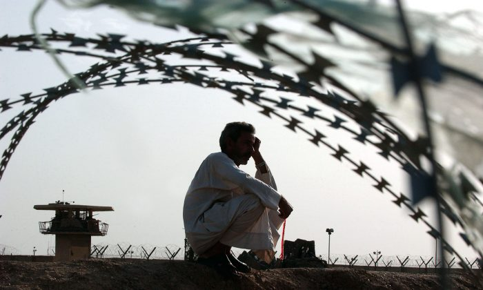An Iraqi man waits for the release of his relative detained in the Abu Ghraib prison, outside of Baghdad, Iraq, on May 21, 2004. (Wathiq Khuzaie/Getty Images)