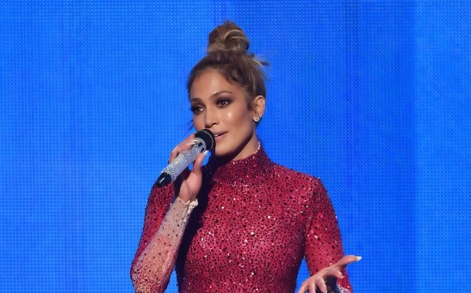 Host Jennifer Lopez performs speaks onstage during the 2015 American Music Awards at Microsoft Theater on November 22, 2015 in Los Angeles, California. (Photo by Kevin Winter/Getty Images)