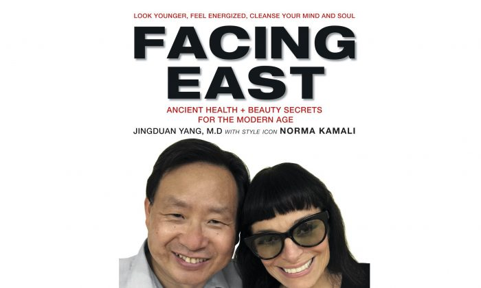 """The book cover of """"Facing East"""" by Jingduan Yang, M.D., F.AP.A. with style icon Norma Kamali. (Courtesy of Harper Collins Publishers)"""