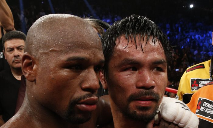 Floyd Mayweather Jr., (L) beat Manny Pacquiao in one of the most anticipated boxing bouts ever. Could there be a rematch? (John Gurzinski/AFP/Getty Images)