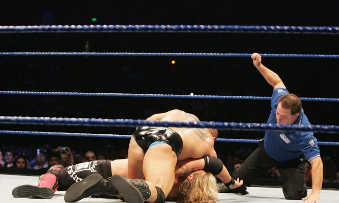 Batista goes for the pin on World Heavyweight Champion Edge during WWE Smackdown at Acer Arena on June 15, 2008 in Sydney, Australia. (Gaye Gerard/Getty Images)