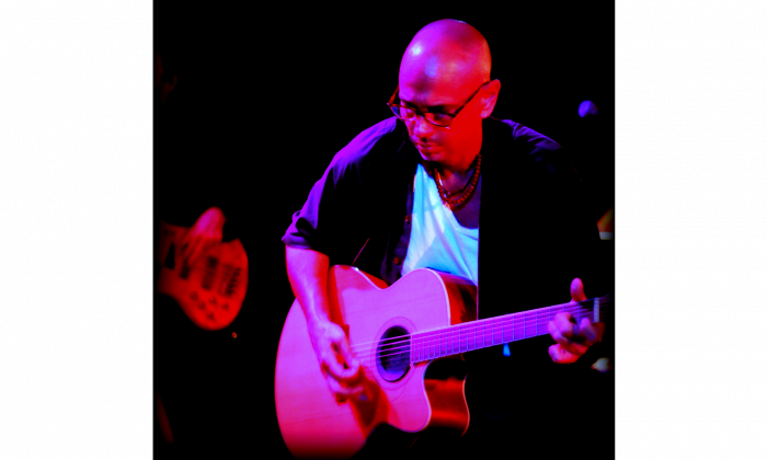 Songwriter, guitarist, and producer Timothy Trieste performs onstage with The Pearls of Life. (Courtesy of Sound of the Muse Records)