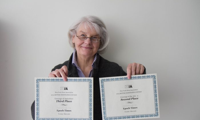Epoch Times Orange County Reporter, Yvonne Marcotte, holds her awards from the New York Press Association. (Holly Kellum/Epoch Times)