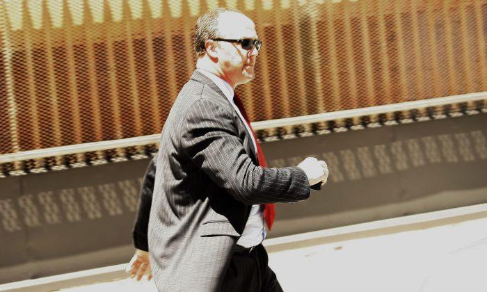 Former UBS banker Bradley Birkenfeld leaves the Fort Lauderdale, Fla. federal court building on Aug. 21, 2009. (AP Photo/J Pat Carter)