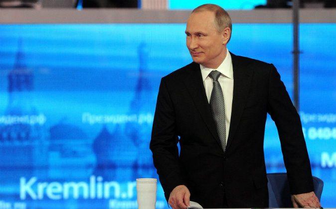 Russian President Vladimir Putin arrives at his annual call-in show in Moscow, Russia, on April 14, 2016. (Mikhail Klimentyev/Sputnik, Kremlin Pool Photo via AP)