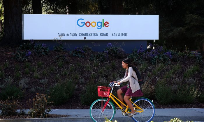 The new Google logo is displayed on a sign outside of the Google headquarters on September 2, 2015 in Mountain View, California. (Photo by Justin Sullivan/Getty Images)