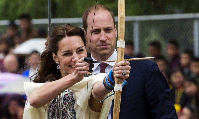 Britain's Catherine, the Duchess of Cambridge, fires an arrow with Prince William, Duke of Cambridge, lat the Changlingmethang National Archery ground in Thimphu during their visit to Bhutan on April 14. (Roberto Schmidt/AFP/Getty Images)