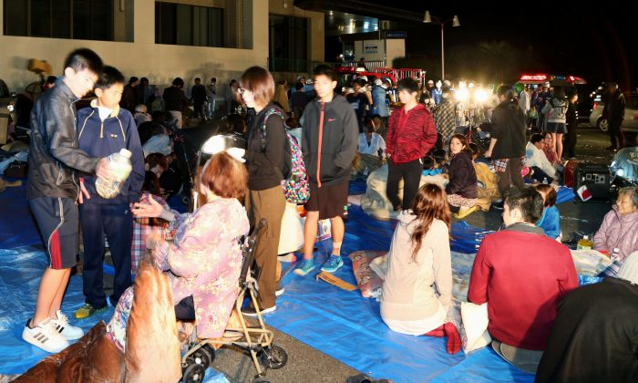 Stranded people gather outside a town hall of Mashiki, after an earthquake in Kumamoto, southern Japan, Thursday, April 14, 2016. (Kyodo News via AP)
