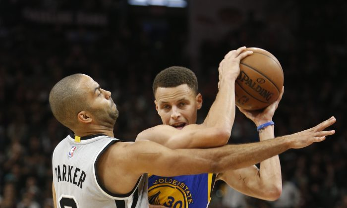 Stephen Curry (R) and the Golden State Warriors would likely have to get past Tony Parker and the San Antonio Spurs in order to repeat as champions. (Ronald Cortes/Getty Images)