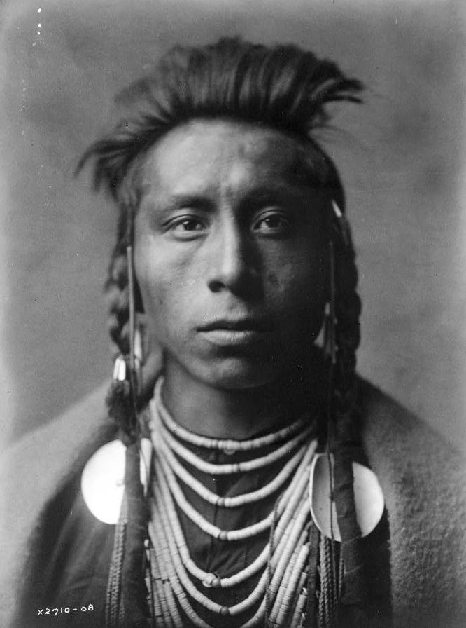Lies Sideway, a Crow man, cc1908. (Edward S. Curtis/Library of Congress)