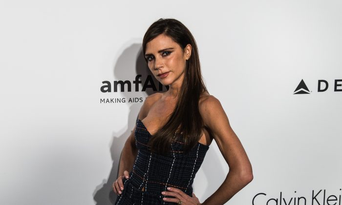 British designer and singer Victoria Beckham arrives for the 2016 American Foundation for AIDS Research (amfAR) Hong Kong gala at Shaw Studios in Hong Kong on March 19, 2016. (ANTHONY WALLACE/AFP/Getty Images)