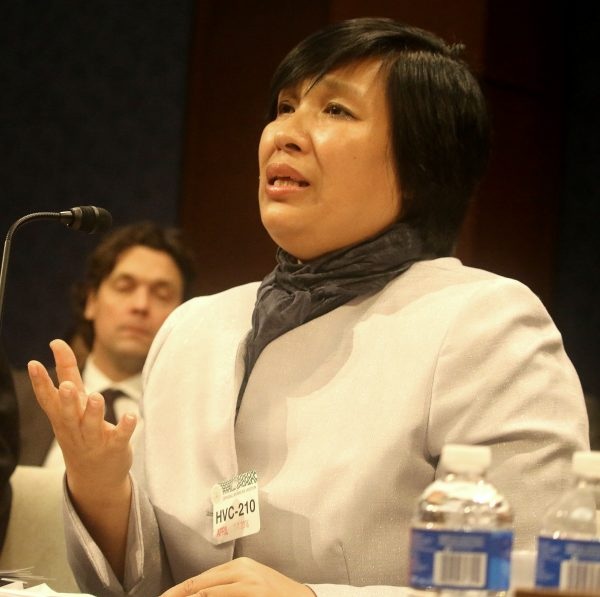 """Yin Liping testifies before the Congressional-Executive Commission on China, April 14, on """"China's Pervasive Use of Torture."""" Ms. Liping is a Falun Gong practitioner who survived torture, forced labor, and sexual violence in Masanjia and other forced labor camps in communist China. (Gary Feuerberg/Epoch Times)"""