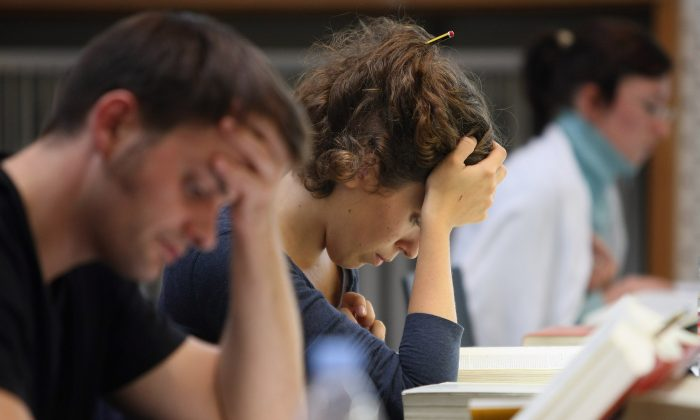 Students study legal texts in the law faculty library at Humboldt University prior to the beginning of the winter semester on October 11, 2011 in Berlin, Germany. (Adam Berry/Getty Images)