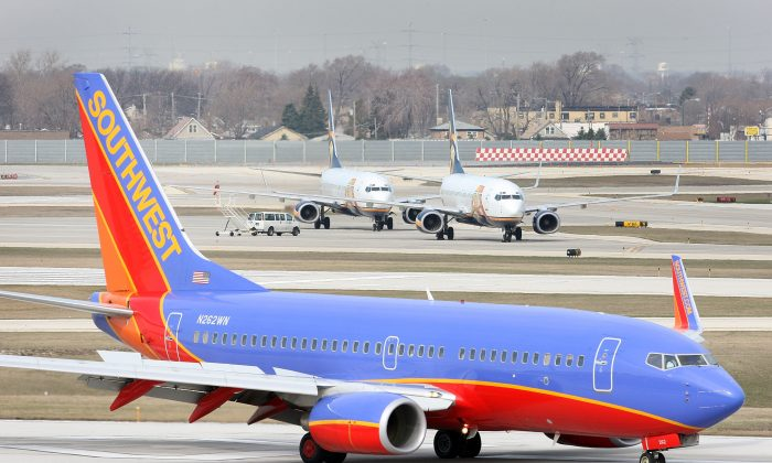 A Southwest Airlines jet passes two ATA Airlines jets sitting on the tarmac at Midway Airport April 3, 2008 in Chicago, Illinois. (Scott Olson/Getty Images)
