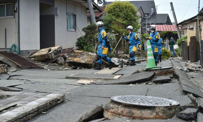 Policemen search for missing people in a damaged neighbourhood following two earthquakes in the region in Mashiki, Kumamoto prefecture, Japan, on April 17, 2016. (Kazuhiro Nogi/AFP/Getty Images)