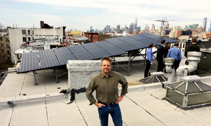 Lawrence Orsini, president and founder of Lo3 energy in front of a rooftop solar panel installation on President St. in Brooklyn, N.Y. (Courtesy of Lawrence Orsini)