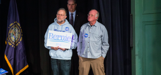 Jerry Greenfield (L) and Ben Cohen listen to Democratic presidential candidate Sen. Bernie Sanders at a rally after endorsing him in Exeter, N.H., on Feb. 5, 2016. (Andrew Burton/Getty Images)