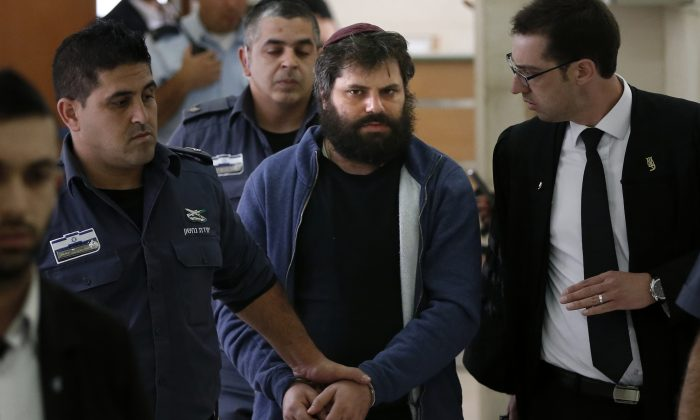 Israeli Yosef Haim Ben-David (C), the ringleader of the killing of Palestinian teenager Mohammed Abu Khdeir last year, is escorted by Israeli policemen at the district court in Jerusalem on April 19, 2016.   An Israeli court ruled that a Jewish man found to be the ringleader of the beating and burning alive of the Palestinian teenager in 2014 was sane and responsible for his actions. Israeli settler Yosef Haim Ben-David, 31, was found in November to have led the assault, but his lawyers had submitted last-minute documents saying he suffered from mental illness.   / AFP / AHMAD GHARABLI        (Photo credit should read AHMAD GHARABLI/AFP/Getty Images)