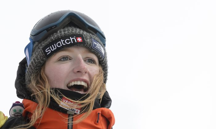 A picture taken on April 2, 2016 shows World champion Switzerland's Estelle Balet celebrating after she won the women's snowboard event at the Bec des Rosses during the Verbier Xtreme Freeride World Tour final above the Swiss Alps resort of Verbier.   (Fabrice Coffrini/AFP/Getty Images)
