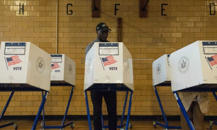 A man votes at Public School 22 on April 19, 2016 in the Brooklyn borough of New York City. (Stephanie Keith/Getty Images)