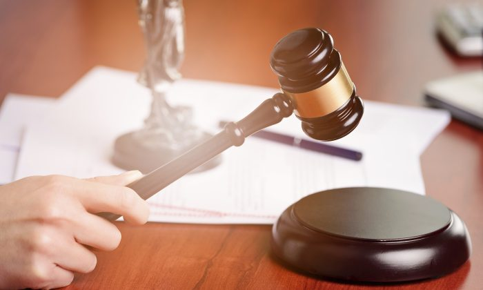 A judge holding a gavel. (iStock)