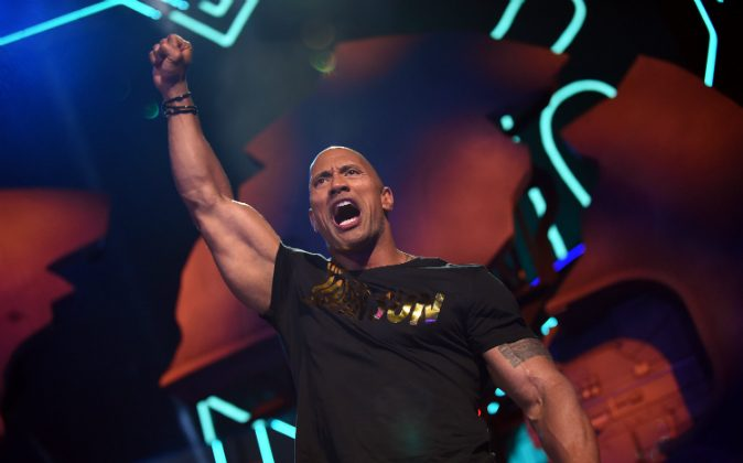 Host Dwayne Johnson speaks onstage during the 2016 MTV Movie Awards at Warner Bros. Studios on April 9, 2016 in Burbank, California. Photo by Emma McIntyre/Getty Images for MTV)