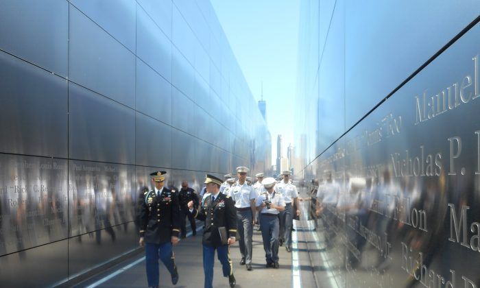 U.S. Army Major Ryan Boeka (L) and U.S. Army Major Aaron Miller (R) lead West Point Cadets through Empty Sky, the New Jersey 9/11 Memorial, in Liberty State Park, Jersey City, on April 14, 2016. (Vincent J. Bove)
