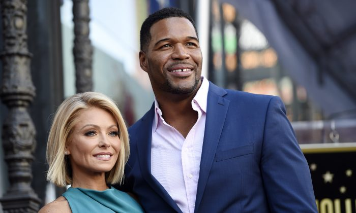 "In this Oct. 12, 2015 file photo, Kelly Ripa, left, poses with Michael Strahan, her co-host on the daily television talk show ""Live with Kelly and Michael,"" during a ceremony honoring Ripa with a star on the Hollywood Walk of Fame in Los Angeles. (Photo by Chris Pizzello/Invision/AP, File)"