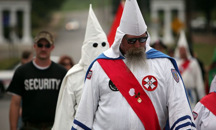 Members of the Fraternal White Knights of the Ku Klux Klan participate in the 11th Annual Nathan Bedford Forrest Birthday march July 11, 2009, in Pulaski, Tennessee. Hackers have launched an online campaign to shut down websites of the KKK and other hate groups. (Spencer Platt/Getty Images)