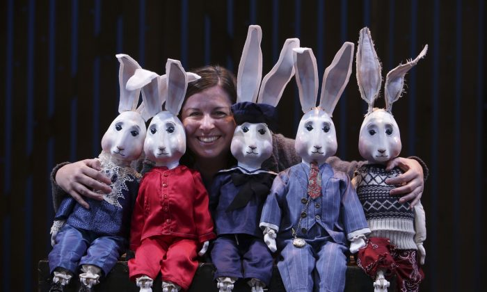 """Rachel Healy amid her creations, costume and puppet design, for """"The Miraculous Journey of Edward Tulane,"""" at The Chicago Children's Theatre. (Charles Osgood Photography)"""