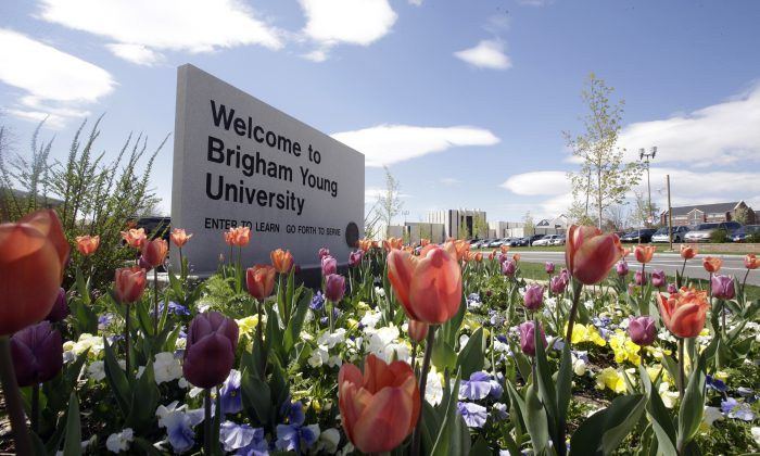 In this Tuesday, April 19, 2016, a welcome sign to Brigham Young University sits at the school in Provo, Utah. BYU students who say they were sexually assaulted are finding themselves under investigation for possible violations of the Mormon school's code against sex and drinking. BYU says it will re-evaluate the practice. (AP Photo/Rick Bowmer)