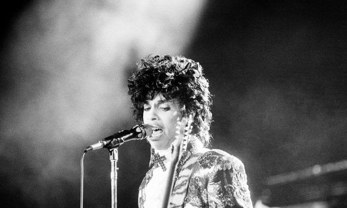 Rock singer Prince performs at the Orange Bowl during his Purple Rain tour in Miami, Fla., April 7, 1985. (AP Photo/Phil Sandlin)