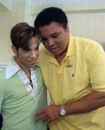 Boxing great Muhammad Ali, right, embraces the Artist Formerly Known as Prince, during a meeting in Washington Tuesday, June 24, 1997 prior to a news conference where they were to announce plans for a benefit concert in October. (AP Photo/Karin Cooper/Rogers & Cowan)