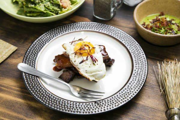 Pork Belly Hash with peppers, onions, potato hash, and runny egg. (Samira Bouaou/Epoch Times)