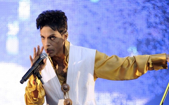 US singer and musician Prince (born Prince Rogers Nelson) performs on stage at the Stade de France in Saint-Denis, outside Paris, on June 30, 2011. (BERTRAND GUAY/AFP/Getty Images)