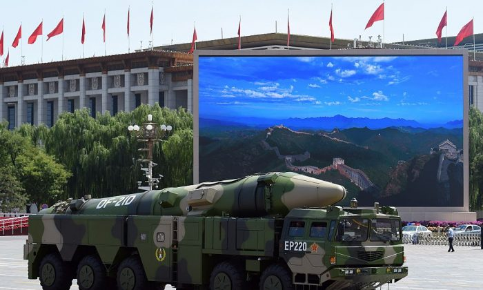 A Chinese military vehicle carries a DF-21D missile after a military parade at Tiananmen Square in Beijing on Sept. 3, 2015. The Chinese regime recently tested a new intercontinental ballistic missile that can allegedly strike the United States. (Greg Baker/AFP/Getty Images)
