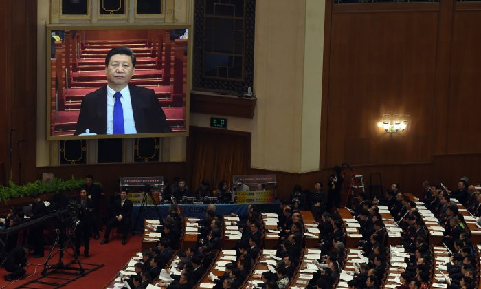 Chinese leader Xi Jinping is on a screen as he prepares for a speach at the Great Hall of the People in Beijing on March 3, 2016. (Greg Baker/AFP/Getty Images)