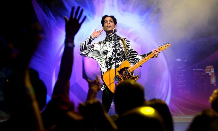 Prince performing at the NOKIA Theatre (now the Mirosoft Theatre) in Los Angeles on March 28, 2009. (Kristian Dowling/Getty Images for Lotusflow3r.com)