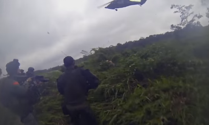 A video still taken from a Columbian special forces helmet cam shows the moment that Édgar Gutierrez Arenas surrenders. The drug kingpin was one of Columbia's top 20 most wanted men. (WarLeaks/YouTube)