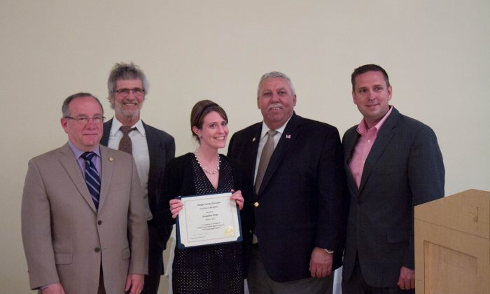 (L-R) Legislator Jeffrey Berkman, Jacqueline Hesse, Legislator James Kulisek, Orange County Executive Steven Neuhaus, and Legislator Matthew Turnbull (back) at the 21st annual Orange County Human Rights Commission dinner at the Fountain in Wallkill on April 21, 2016. Hesse was presented with a human rights award for her work as an English teacher at the Excelsior Academy in the Newburgh Enlarged School District. (Holly Kellum/Epoch Times)