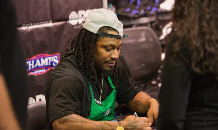 Seattle Seahawks Running Back Marshawn Lynch attends in store appearance for the launch of BEASTMODE x PSD at Champs at Bellevue Square on November 13, 2015 in Bellevue, Washington.  (Photo by Mat Hayward/Getty Images for PSD Underwear)