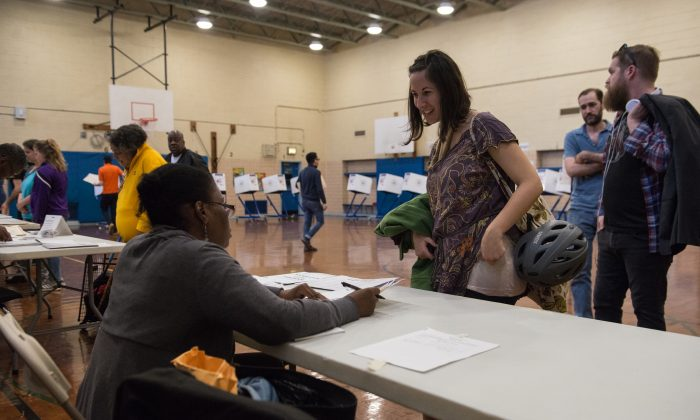 A woman checks into her voting station at Public School 22 on April 19, 2016 in the Brooklyn borough of New York City. Voters are going to the polls in New York for the presidential primary election. (Photo by Stephanie Keith/Getty Images)