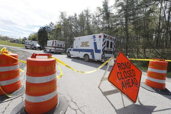 Law enforcement has closed down Union Hill Road in Pike County, Ohio, while they investigate a shooting with multiple fatalities on Friday, April 22, 2016.  Authorities say multiple people have been shot to death in rural Ohio, some 70 miles east of Cincinnati.  (Chris Russell/The Columbus Dispatch via AP)