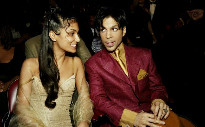 Singer Prince (R) and his then wife Manuela Testolini sit in the audience at the 35th Annual NAACP Image Awards held at the Universal Amphitheatre in Hollywood, Calif., on March 6, 2004. (Frank Micelotta/Getty Images)