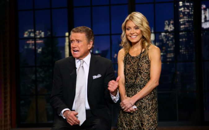 Regis Philbin and Kelly Ripa on set during Regis Philbin's Final Show of 'Live! with Regis & Kelly' at the Live with Regis & Kelly Studio on November 18, 2011 in New York New York. (Photo by Neilson Barnard/Getty Images)
