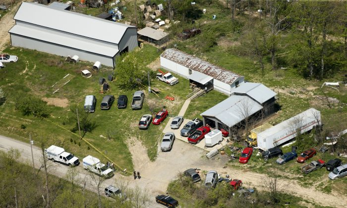 This aerial photo shows one of the locations being investigated in Pike County, Ohio, as part of an ongoing homicide investigation, on April 22, 2016. Several people were found dead Friday at multiple crime scenes in rural Ohio, and at least most of them were shot to death, authorities said. No arrests had been announced, and it's unclear if the killer or killers are among the dead. (Lisa Marie Miller/The Columbus Dispatch via AP)