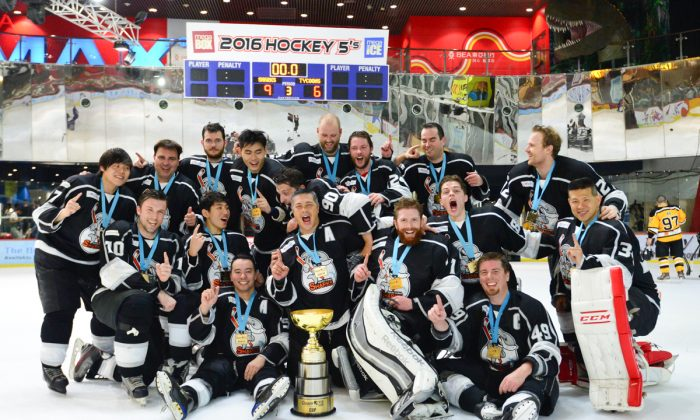 South China Sharks celebrate winning the CIHL playoffs to take the Quam Cup at Mega Ice on Thursday April 21, 2016.  (Bill Cox/Epoch Times)