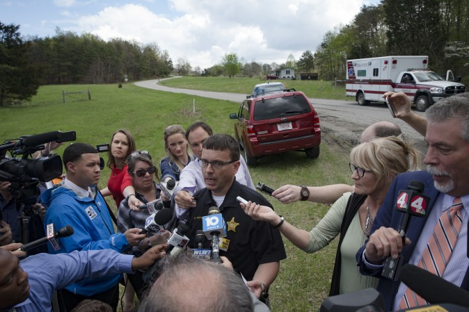 Lt. Michael Preston, of the Ross County Sheriff's Department speaks to the media on Union Hill Road that approaches a crime scene, in Pike County, Ohio, on April 22, 2016. (AP Photo/John Minchillo)