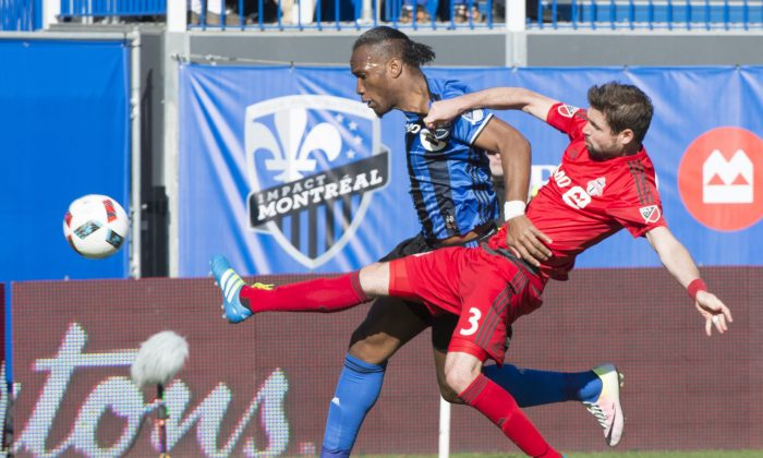 Toronto FC defender Drew Moor stretches to knock the ball away fromMontrealImpact forward Didier Drogba at Stade Saputo in Montreal on April 23, 2016. (The Canadian Press/Paul Chiasson)